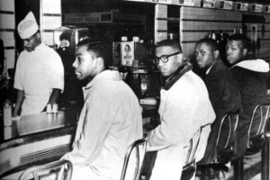 Photo of the Greensboro Four sitting at the Woolworth lunch counter